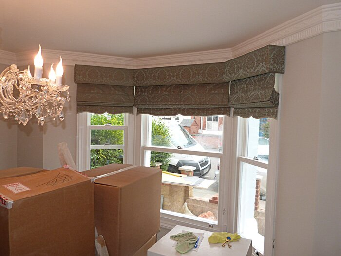 New roman blind installation in sitting room